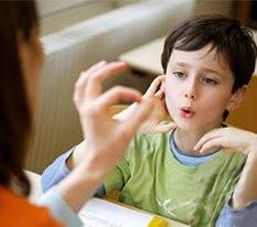 child under taking speech therapy
